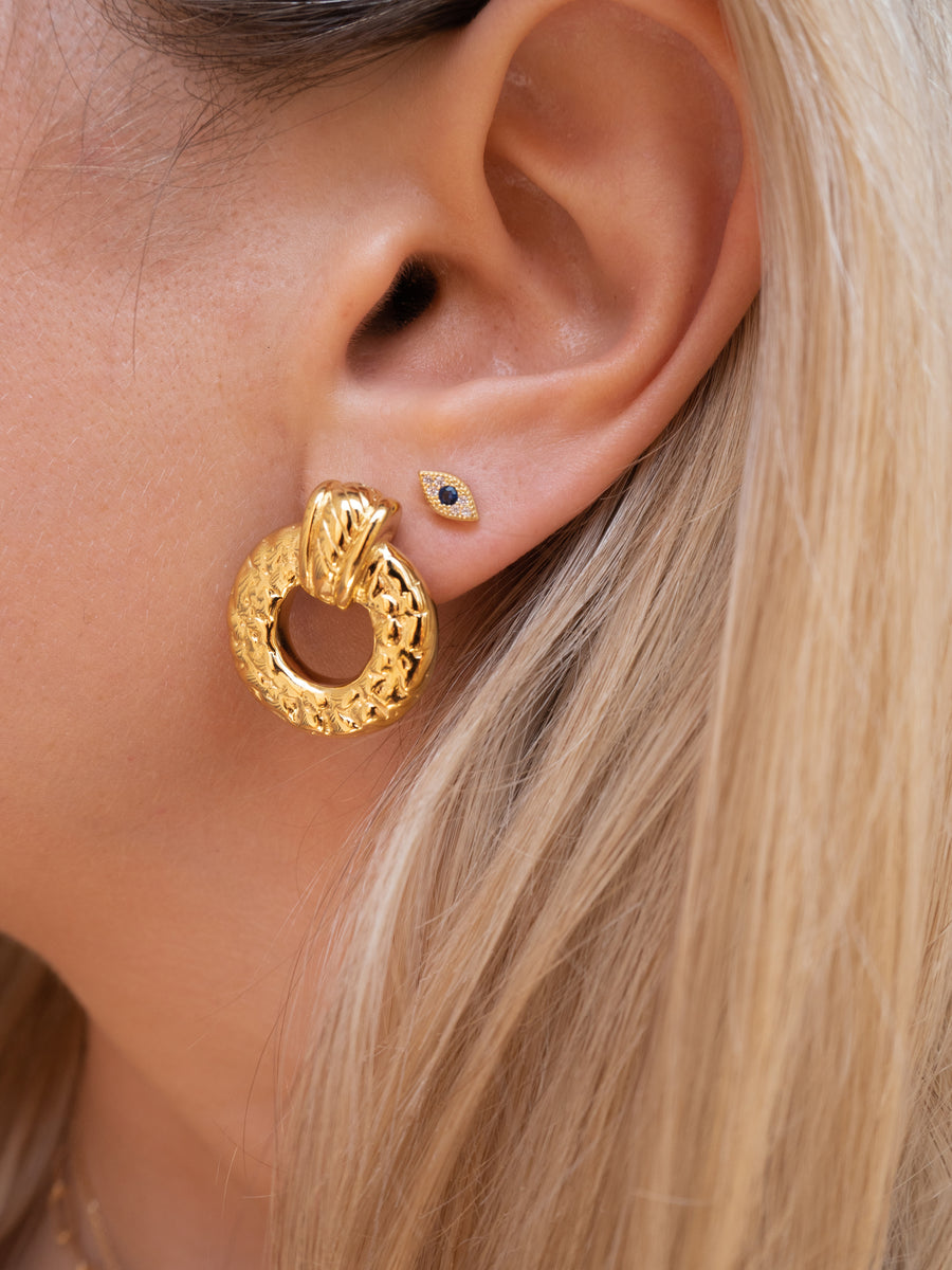 Dainty mini evil eye stud earring in 14k gold vermeil by vie en bleu jewelry.