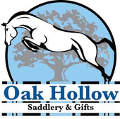 Oak Hollow Saddlery & Gifts tack shop logo. Horse jumping over striped jump rails with a large grey oak tree with a light blue background.