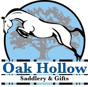Store Logo. Horse jumping over striped jump rails with a large grey oak tree with a light blue background.  Oak Hollow Saddlery & Gifts is displayed between the rails.