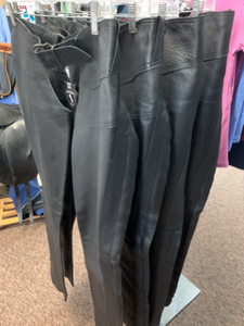 Black leather full-leg chaps (pants) for horseback riding