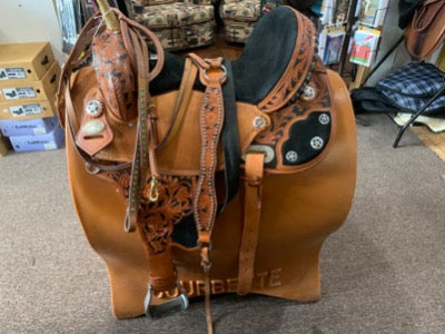 Light brown fancy western saddle with high back black suede seat.  Has a matching bridle and breastplate.  All with embellishments