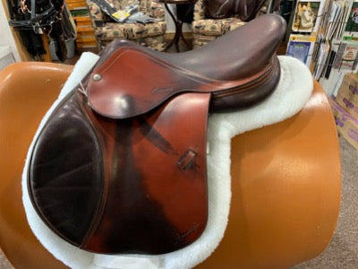 English style equestrian riding saddle.  Two tones of tan and dark brown.  Padded knee rolls.