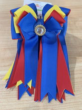 Pretty blue, red and yellow ribbon equestrian show bows