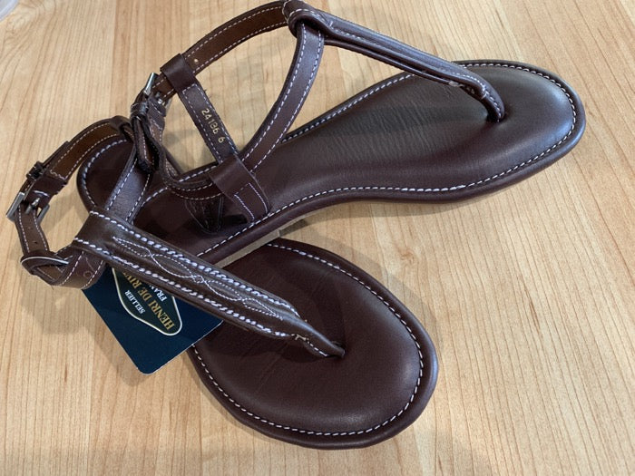 Brown ladies sandals with the between the toes strap that looks like an equestrian fancy stitched bridle.