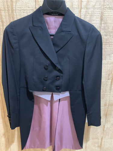 This is a navy, long tail classic shadbelly show jacket for any equestrian! Suitable for riders on all levels. Its has purple lining and a plaid accent with like colors.
