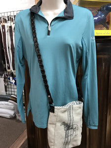 Mannequin wearing an equestrian riding shirt modeling a cross body purse that is tan burlap satchel with blue stripes down the center and a black sketched horse,  The shoulder strap of the satchel purse is real braided leather equestrian reins.