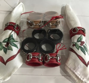 Red, tan and black sets of four leather wrapped equestrian napkin rings with silver snaffle bits.