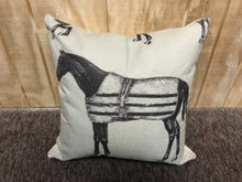Light canvas throw pillow with picture of a dark horse wearing a stable blanket