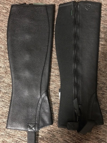 Black leather half chaps with side zipper and elastic strap for under shoe.