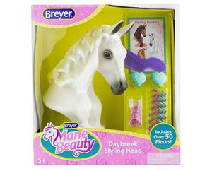 Breyer white horse head with a long mane so that kids can brush and braid.  Displayed in box along with accessories styling tools