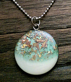 Resin Circle Necklace Baby Blue and White with mixed leaf Stainless Steel. 30mm Circle Pendant.