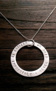 "Hand Stamped Circle Necklace ""Nothing is impossible . Never Give Up "" Ready to post. - Silver and Resin Designs"