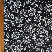 White Daisies on Black Cotton Knit Fabric