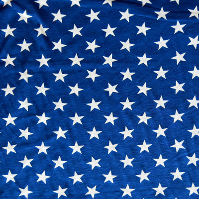 White Patriotic Stars on Royal Cotton Knit Fabric