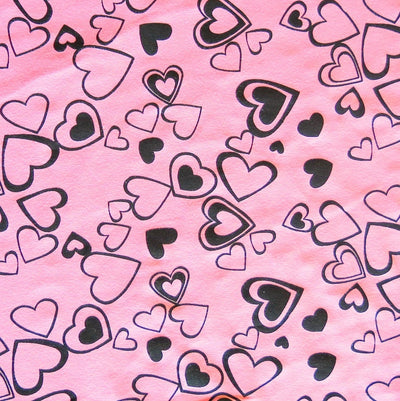 Black Hearts on Pink Cotton Spandex Knit Fabric