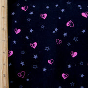 Broken Hearts and Stars on Black Cotton French Terry Fabric