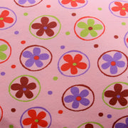 Daisies, Dots, and Circles on Pink Cotton Lycra Knit Fabric