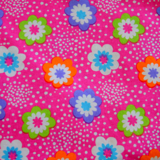 Daisies and Dots on Pink Cotton Knit Fabric by Anita G