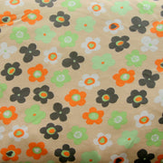 Orange, White, Lime, and Black Daisies on Tan Cotton Lycra Knit Fabric