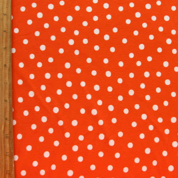White Dotty Dots on Brilliant Orange Cotton Lycra Knit Fabric