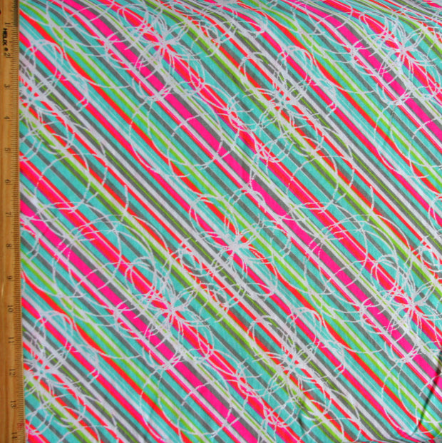 Fluorescent Bias Stripes with Daisies Cotton Knit Fabric by Anita G