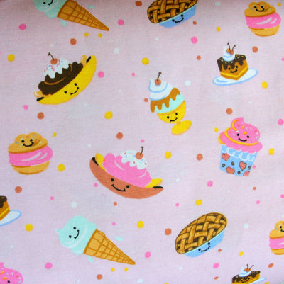 Happy Treats on Pink Cotton Knit Fabric