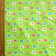Hearts and Flowers on Lime Cotton Knit Fabric