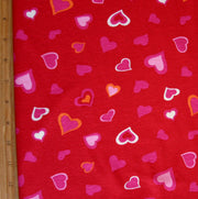 "Pink, White, and Orange Hearts on Red Cotton Knit Fabric - 26"" Remnant Piece"