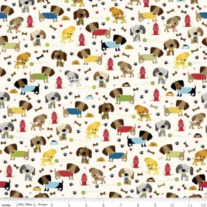 Rover Dog Park Cream Cotton Lycra Knit Fabric by Riley Blake