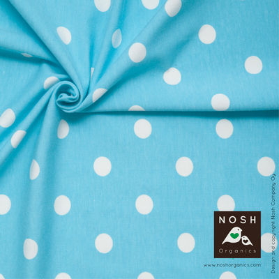 Natural Polka Dots on Capri Blue Organic Cotton Lycra Knit Fabric by Nosh Organics