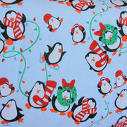 Playful Holiday Penguins Cotton Knit Fabric
