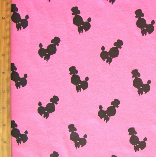 Black Poodles on Pink Cotton Knit Fabric