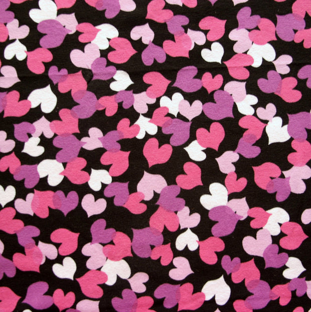 Purple, White, Pink, and Magenta Hearts on Black Cotton Lycra Knit Fabric