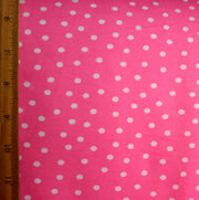 Scattered White Polka Dots on Pink Cotton Knit Fabric by Anita G