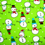 Snowmen and Polka Dots on Lime Cotton Knit Fabric
