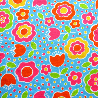 Tulips, Daisies, and Dots on Blue Cotton Lycra Knit Fabric