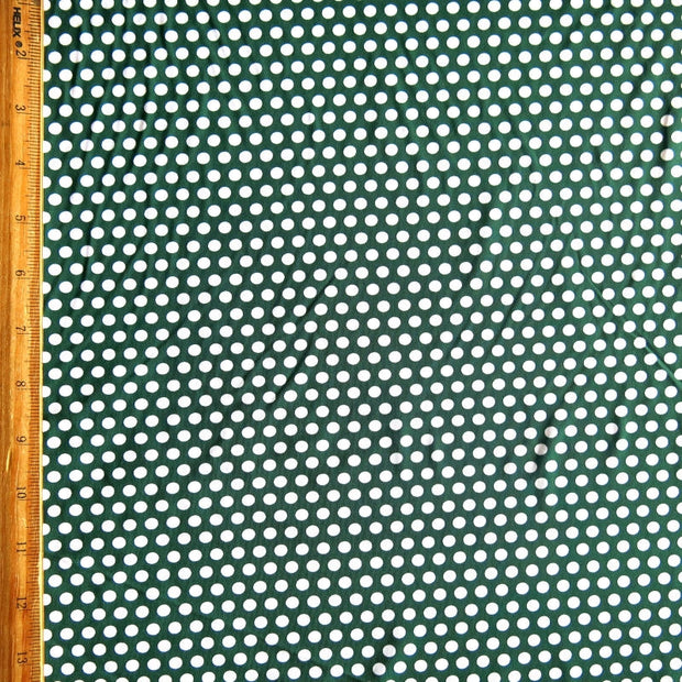White Aspirin Polka Dots on Hunter Green Nylon Spandex Swimsuit Fabric