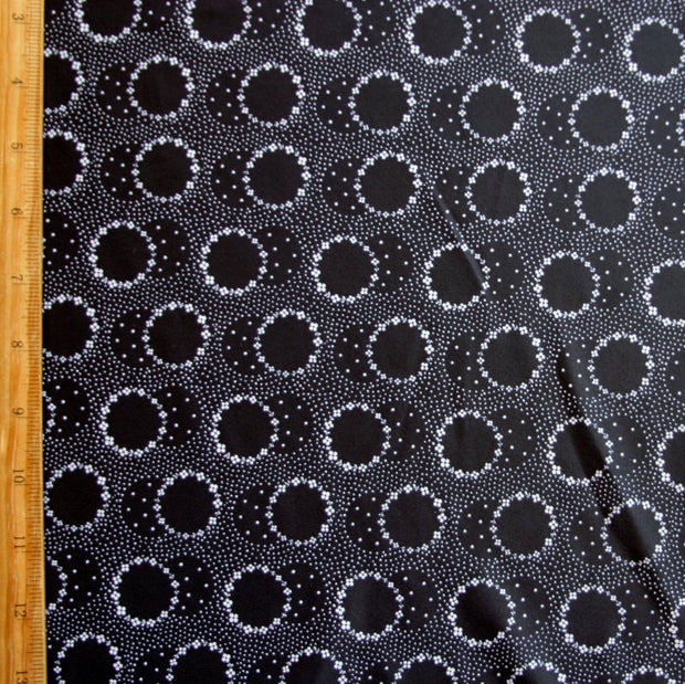 White Daisey Circles on Black Nylon Spandex Swimsuit Fabric