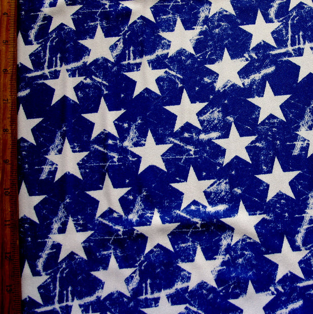"White Distressed Stars on Royal Nylon Lycra Swimsuit Fabric - 14"" Remnant"