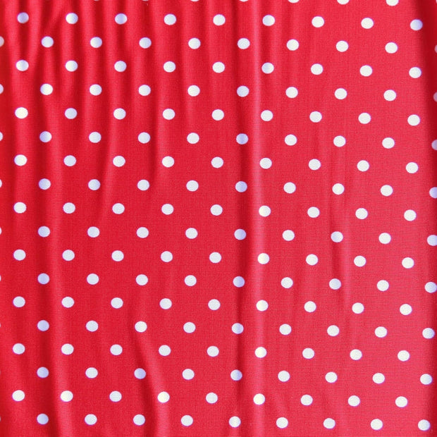 Pink Eraser Polka Dots on Red Nylon Spandex Swimsuit Fabric