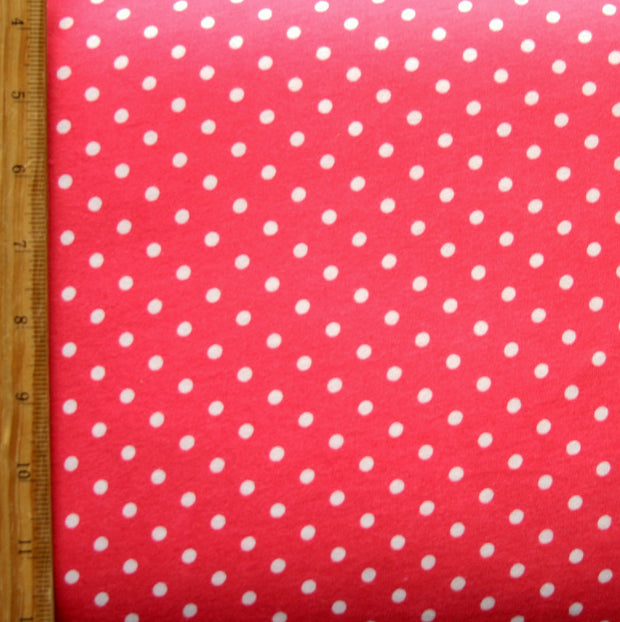 White Eraser Polka Dots on Coral Pink Cotton Knit Fabric
