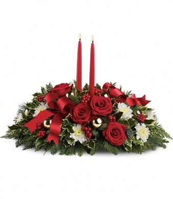 Christmas greens and red roses with a dash of white.  Orleans florists prints on flowers for a unique experience.