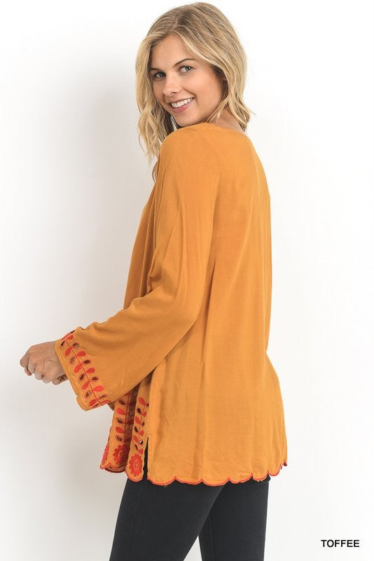 Mustard top with scalloped hem embroidered detail