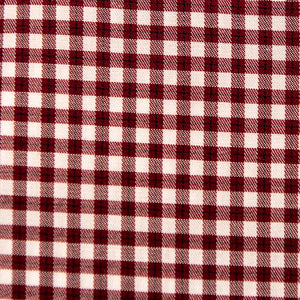 A swatch of Gadsten Garnet Gingham fabric