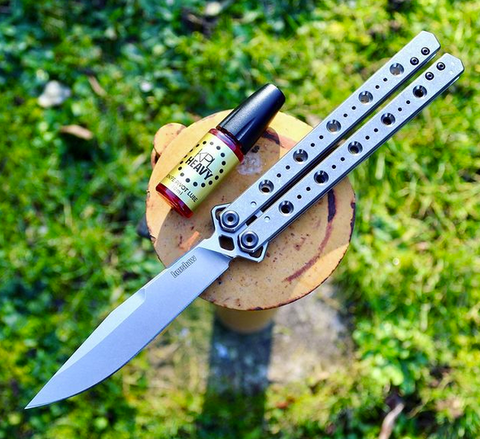 Use Knife Pivot Lube as the best butterfly knife oil