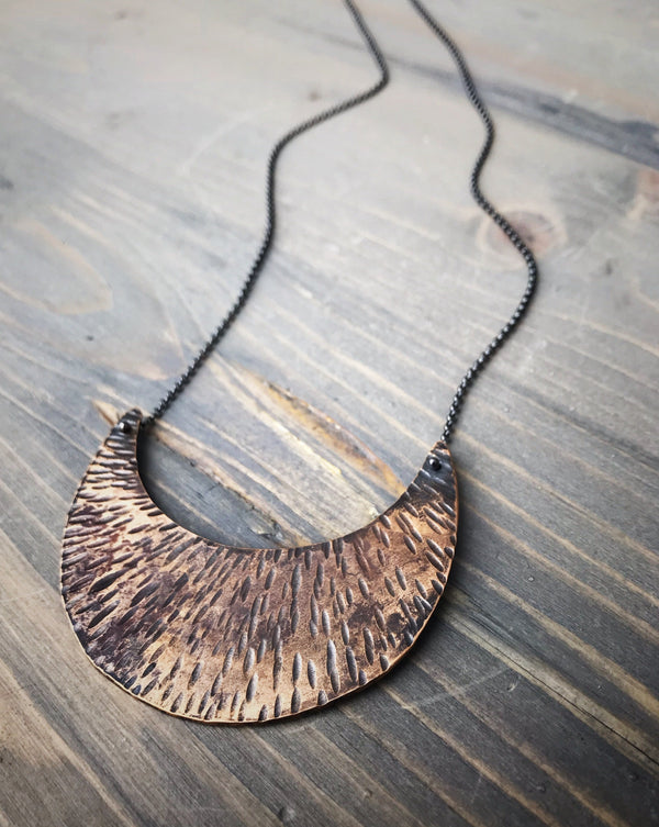 Symbology by Alice Scott necklace made by a local artist in Asheville, North Carolina. Bronze crescent moon on oxidized sterling silver chain.