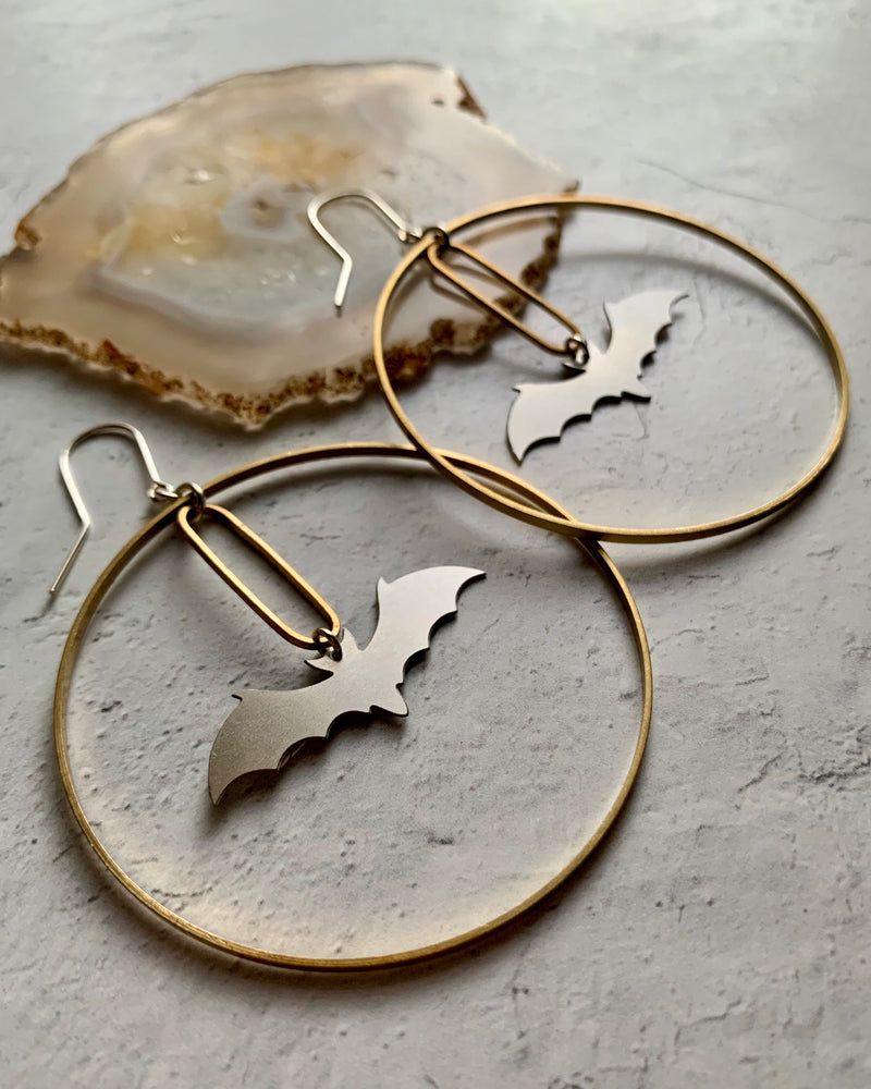 • DARK KNIGHT ECLIPSE •  mixed metal medium hoop earrings