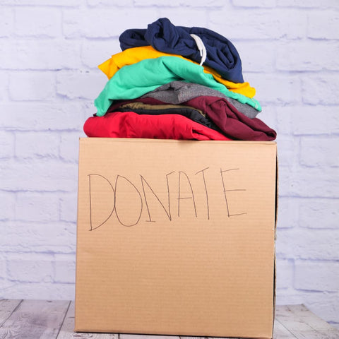 a box of donated, second-hand clothes