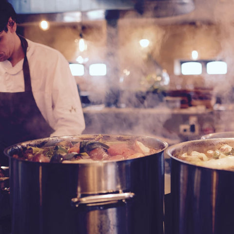 a chef cooking stew for a B Corp certified kitchen