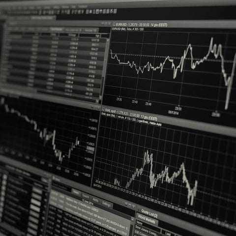 computer graphs monitoring economic cycles and trends